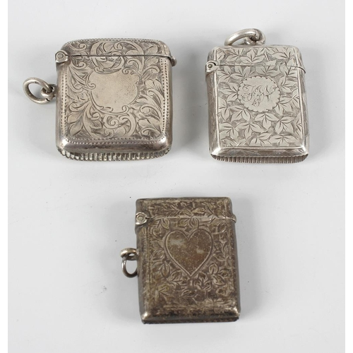 338 - Four Victorian and later silver vesta cases, comprising three having foliate engraving framing a cen...