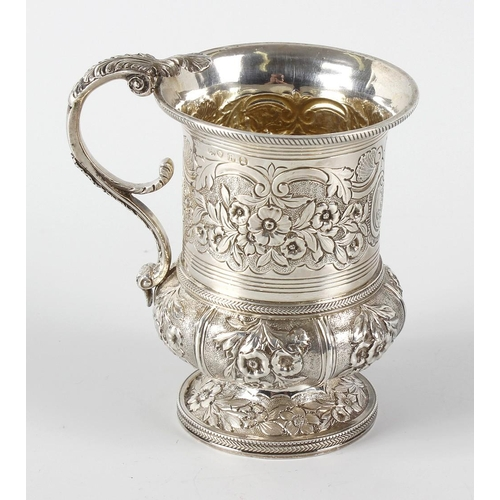 339 - A George IV silver christening mug, of squat bellied form having a foliate capped scrolling handle a...