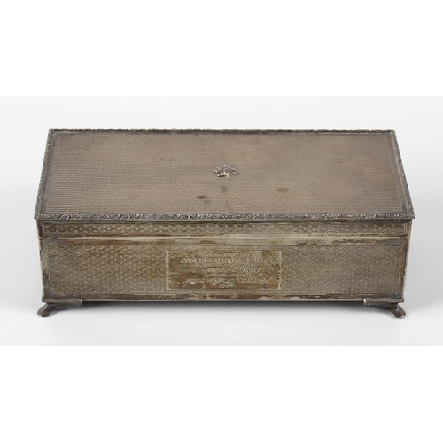 342 - A 1960's silver mounted table cigarette box, having a textured exterior with presentation engraving ...