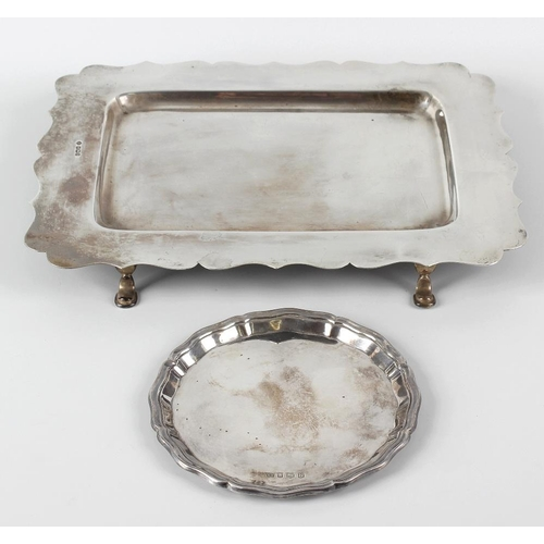350 - A George V silver tray, or rectangular form having a scalloped rim and raised upon four short feet, ...