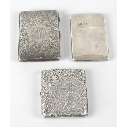 353 - Two Edwardian silver card cases, the first decorated with foliate scrollwork opening to a leather li...