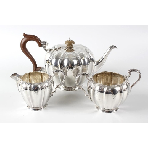 355 - A hallmarked silver three piece tea set, by The Goldsmiths & Silversmiths Company Ltd, comprising a ...
