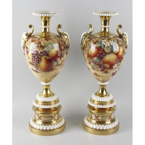 36 - A fine large pair of Royal Worcester porcelain vases, each of baluster form having waisted neck and ...