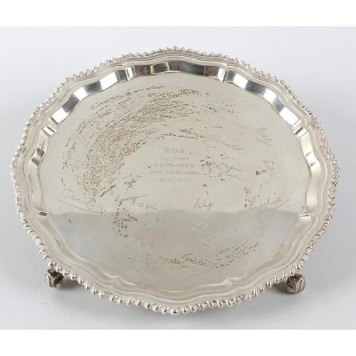 363 - A silver salver, of circular form with a Chippendale style rim to engraved centre, detailed with per...