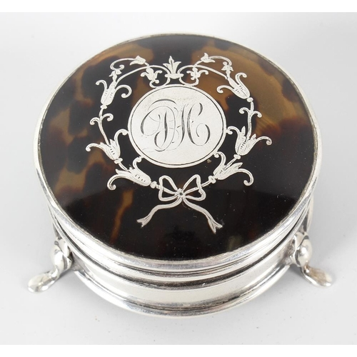 368 - A hallmarked silver and tortoiseshell trinket box, the hinged circular tortoiseshell panelled top wi...