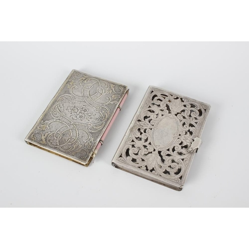 376 - A 19th century notebook with hinged, scroll engraved opening white metal cover, 3.5 (9cm) high, toge...