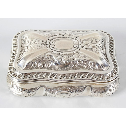 380 - A Birmingham 1901 hallmarked silver snuff box of shaped form, the domed hinged rectangular cover lif...