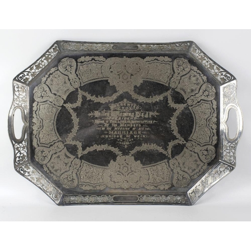 391 - A silver plated tray, of rectangular form with canted edges, having pierced vine rim, the central pe...