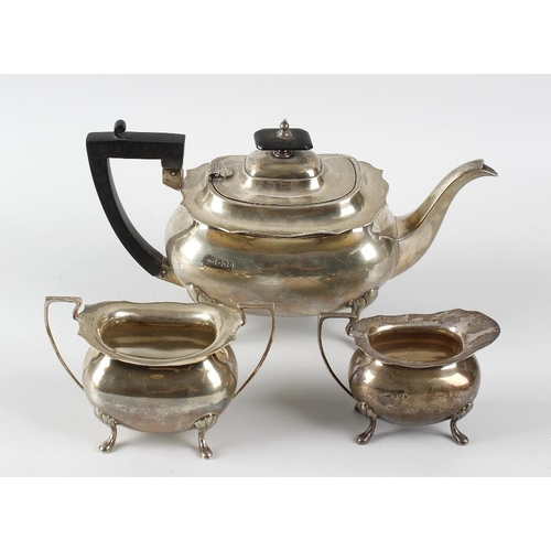 396 - A Walker and Hall three piece silver teaset, comprising teapot, sucrier and milk jug, each of plain ...