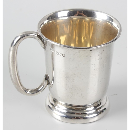 398 - An Edward Viner silver christening mug, of plain tapering form, upon a stepped foot, hallmarked Shef...