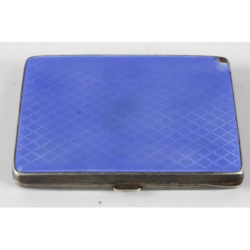 401 - A silver and enamel cigarette box of oblong form, the reverse with engine turned diamond pattern, th...