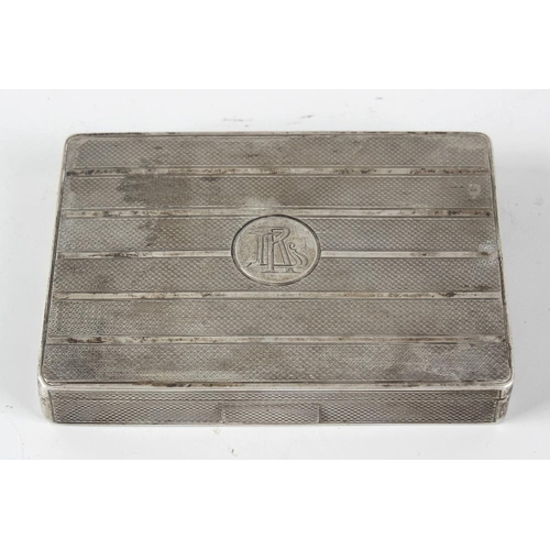 403 - A Continental white metal cigarette box, the body of rectangular form with engine turned banded deco...