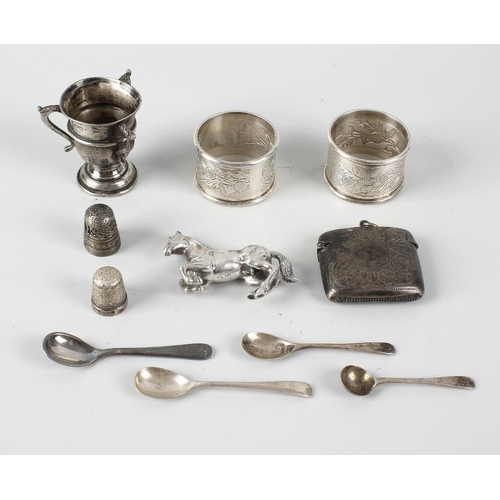 407 - A group of assorted small silver items, to include two silver napkin rings, each of circular form wi...