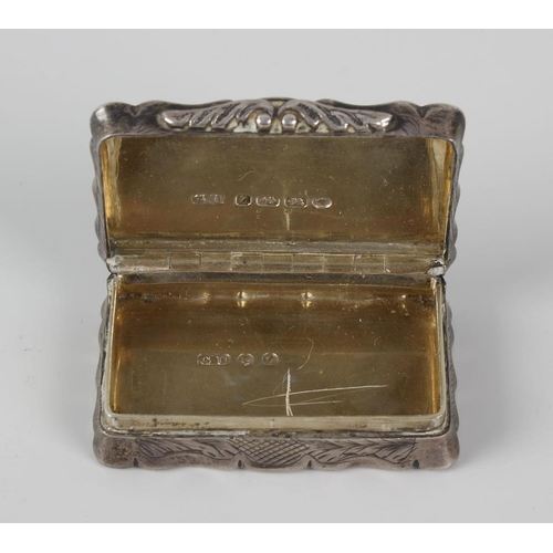 408 - A Victorian silver snuffbox, the oblong body, with scalloped edges, having engraved foliate design t...