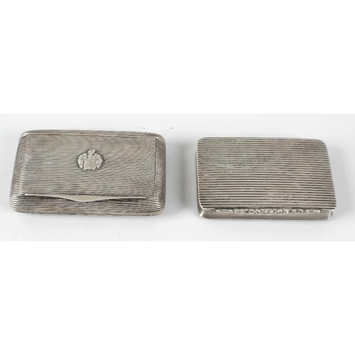409 - Two continental white metal cigarette boxes, the first of oblong form with ribbed decoration to the ...