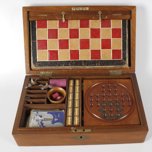 427 - A Victorian mahogany cased games compendium, the rectangular case with hinged opening cover lifting ...
