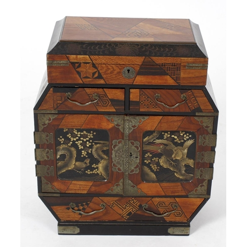 430 - An early 20th century oriental parquetry and lacquered table top cabinet, the hinged opening top lif...