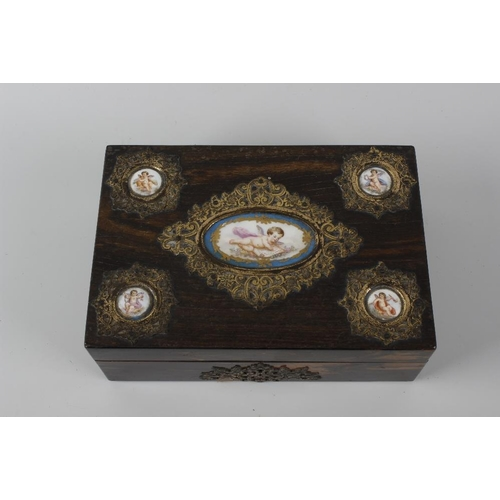 431 - A 19th century coromandel box of rectangular form, the hinged cover opening to reveal a plush dark g...
