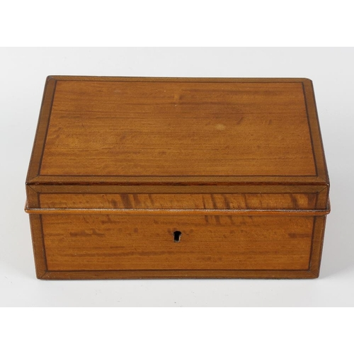 433 - An Edwardian satinwood desk box. The hinged rectangular cover with stringing and crossbanding to bor...
