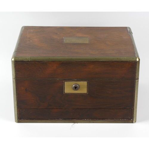 436 - A Victorian brass-bound rosewood dressing dressing box or vanity case. The hinged rectangular cover ...