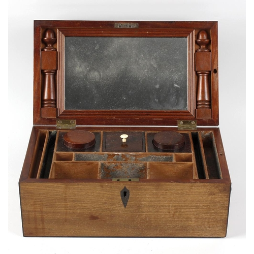 437 - A Regency mahogany dressing box. The hinged rectangular cover with strung edges, enclosing a mirror ...