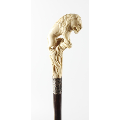465 - A 19th century Meiji period carved ivory walking cane, the pierced carved ivory handle modelled as a...