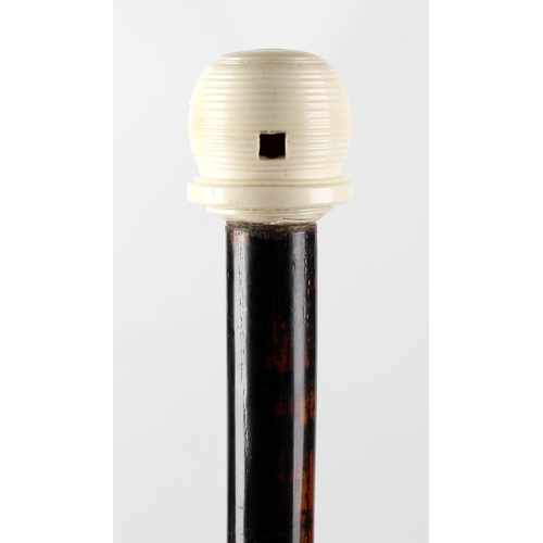 478 - An ivory mounted walking stick, having a turned knop handle with internal reflector behind a square ...