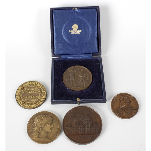 490 - Five assorted medallions to include bronze Notre Dame Cathedral example, another French medallion, F...
