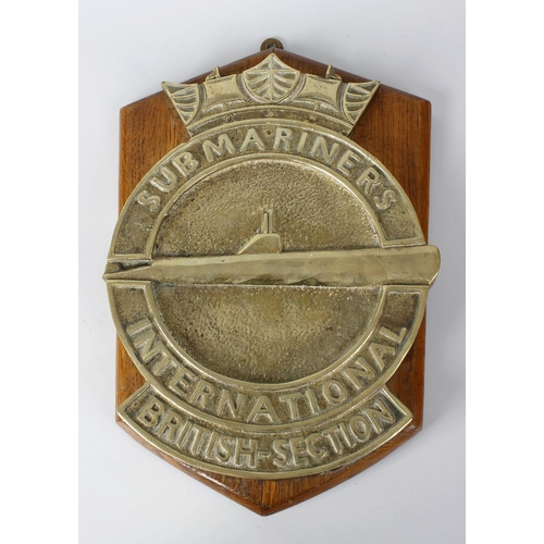 493 - A box containing a heavy cast brass 'Submariners International' wall hanging plaque, upon oak shield...