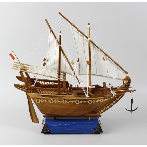 495 - A model of a ketch sailing boat, the wooden hull with yellow metal detail, two masts supporting fabr...