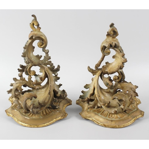 497 - A pair of giltwood and gesso wall brackets, each of ornate stylised form, 10.25 (26cm) high.  <br>Ea...