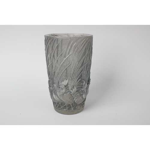 5 - A Rene Lalique glass 'Coqs et Plumes' vase, design introduced 1928, of tapering cylindrical form mou...