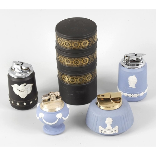 50 - A collection of sixteen Wedgwood jasperware cigarette lighters, to include an unusual three-section ...