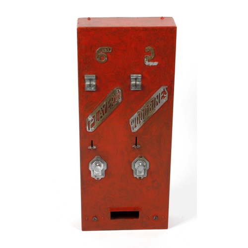 504 - A painted metal cigarette dispensing machine, the rectangular front having two coin slots over pierc...
