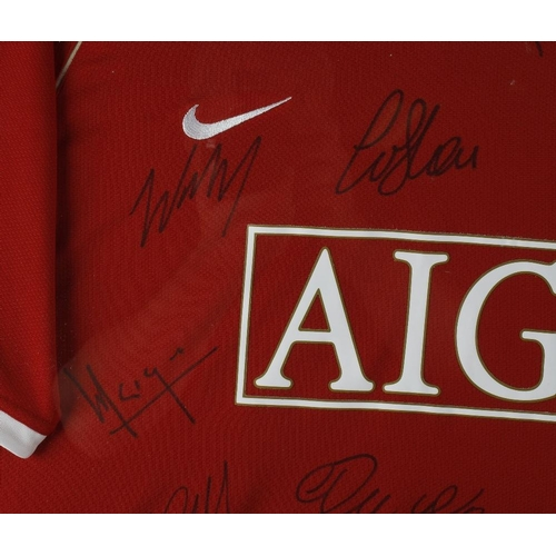 508 - A framed and glazed Manchester United Nike football shirt, circa 2006/7, signed in black marker by n...