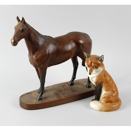 52 - A Royal Worcester model of a seated fox, 7.5 (19cm), together with a Beswick bay horse, Arkle Champi...