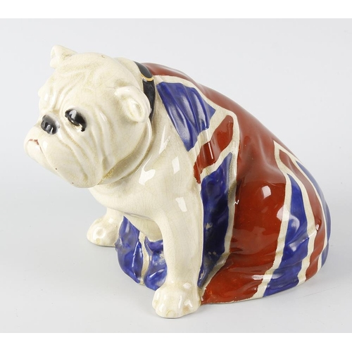 54 - A Royal Doulton study of a bulldog seated and draped in the Union flag, being a caricature of Winsto...
