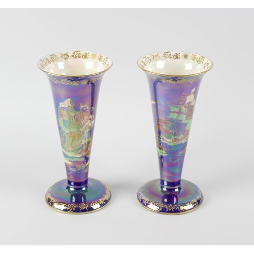55 - A pair of Fieldings Crown Devon lustre vases, of trumpet form on spreading circular foot, each with ...