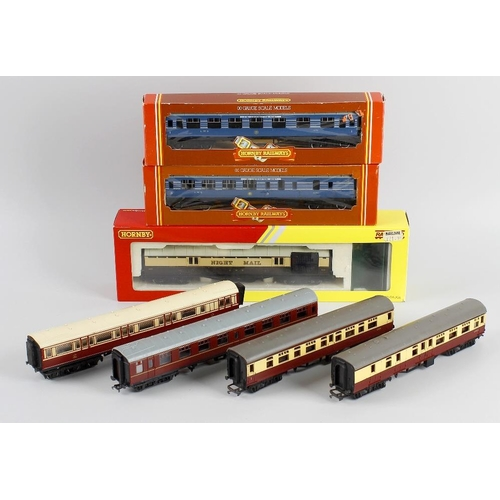 563 - A box containing a Hornby 00 gauge model railway 'Coronation' locomotive and tender, two boxed Coron...