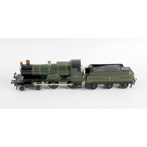 573 - An 0 gauge tinplate and metal bodied clockwork model railway 'County of Oxford' locomotive and tende...