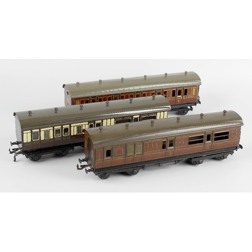 584 - Four Bassett Lowke 0 gauge model railway passenger coaches, to include GWR 3rd class composite coach...