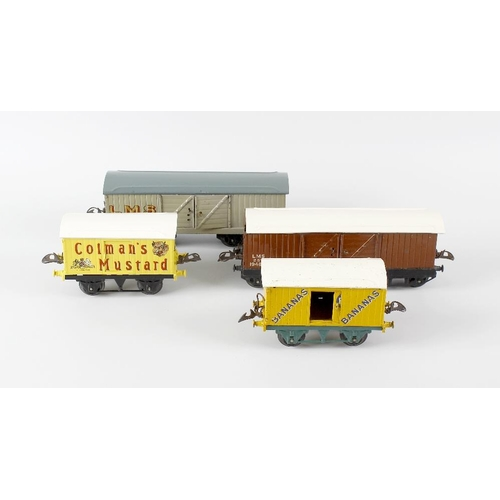 589 - A box containing a good mixed selection of assorted Hornby and other 0 gauge model railway rolling s...