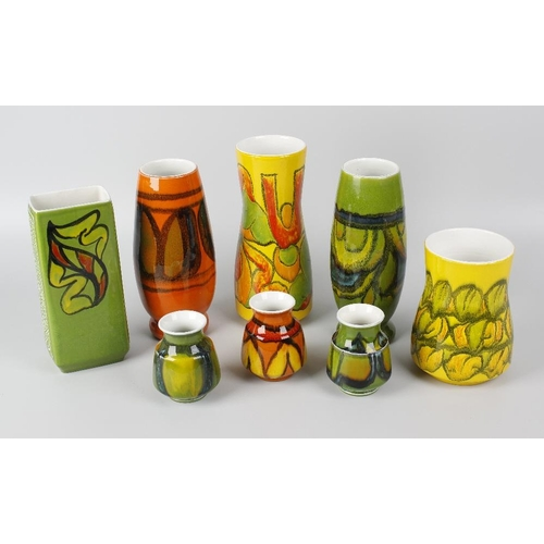 59 - Eight various Poole pottery Delphis pattern vases, largest 9.25 (23.5cm) high.  <br>All with crazing...