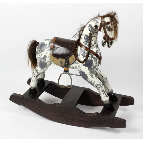 592 - A small 20th century dapple grey rocking-horse With horse-hair mane and tail, leather saddle with st...