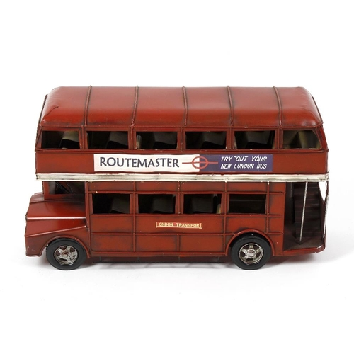 595 - A model double-decker London bus 'Routemaster' 137, in painted sheet metal with decals, 20 long x 11...