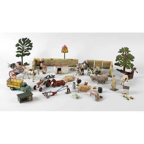 596 - An early 20th century hand made, hand painted wooden toy farm, together with a good mixed selection ...
