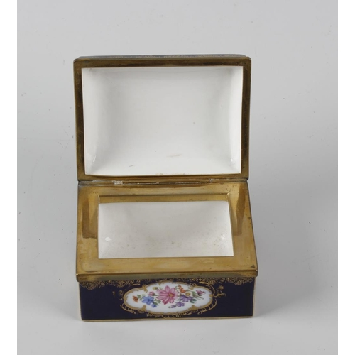 60 - A 19th century porcelain box, of rectangular form, the dark blue glaze decorated with four floral pa...
