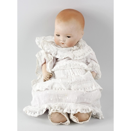 602 - A box containing an Armand Marseille bisque headed 'Dream Baby' doll, a composition pot headed doll,...