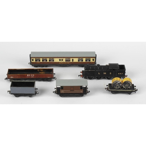 605 - A mixed collection of toys and children's collectables, to include a Hornby Dublo electric locomotiv...