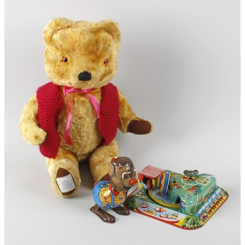 607 - A box containing a Chad Valley gold plush teddy bear, 14 (36cm) tall, another Chad Valley 'Washable ...